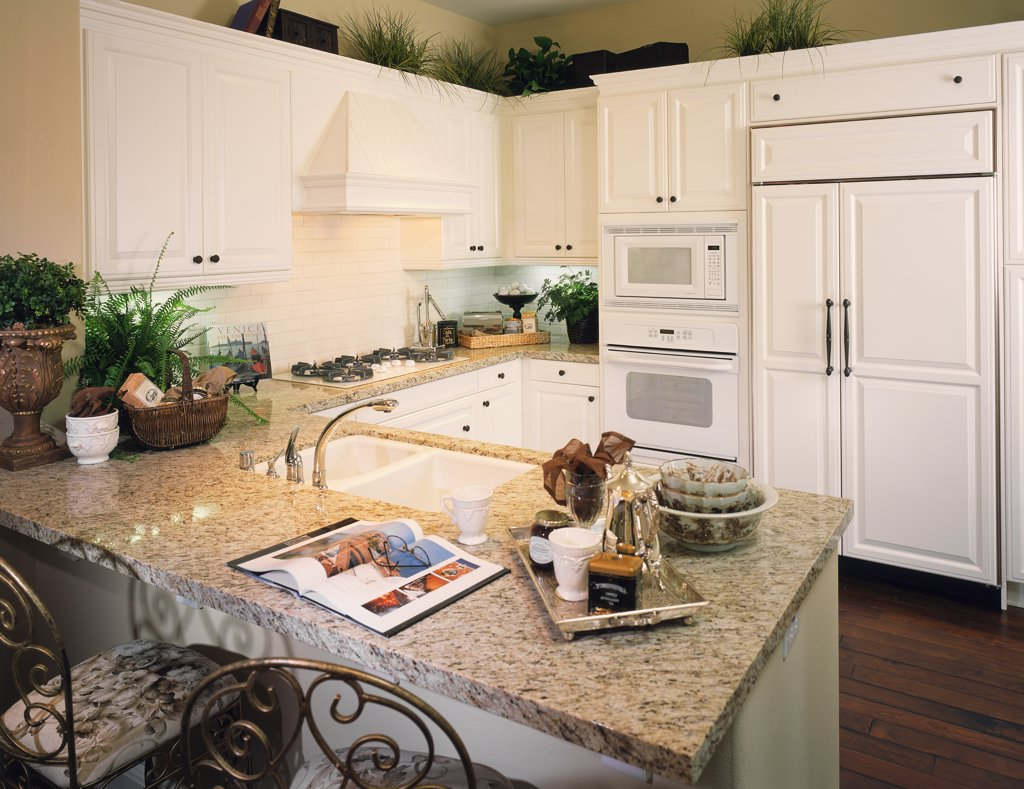 Light colored traditional kitchen : Stock Photo