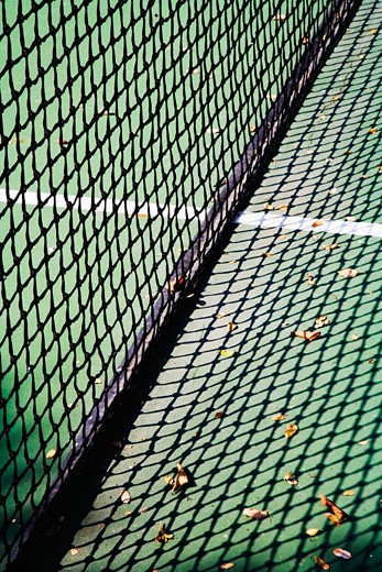 Stock Photo: 1806R-8805 Detail of net and shadow on tennis court