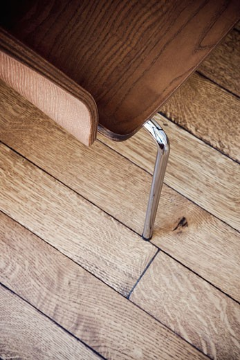 High angle wooden chair detail on hardwood floor : Stock Photo