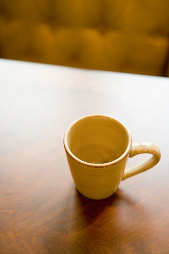 Empty coffee mug on wooden dining table : Stock Photo