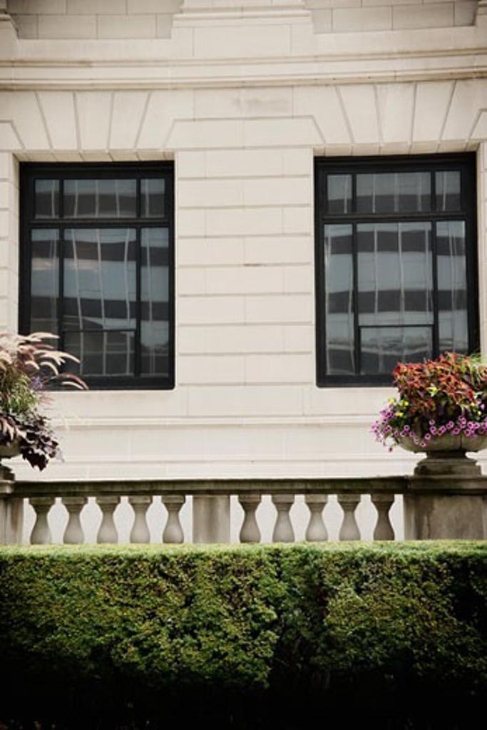 Stock Photo: 1806R-9597 Floral arrangement on railing of terrace