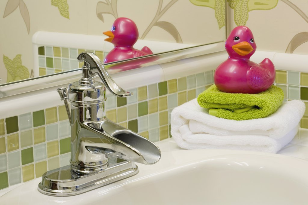 Pink Rubber Duck Next to Sink : Stock Photo