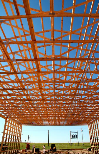 Wooden framework of a commercial building under construction : Stock Photo