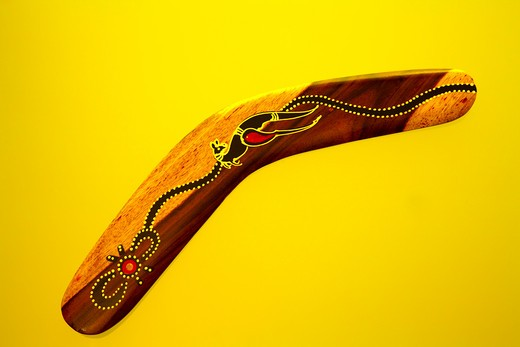Stock Photo: 1807-201 Close-up of a boomerang against yellow background, Australia
