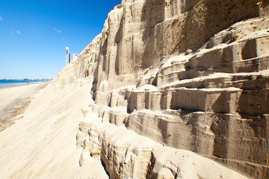 Australia, Gold Coast, Surfers Paradise, Sand erosion on beach : Stock Photo