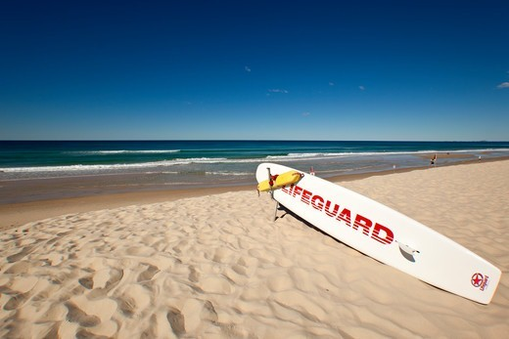 Stock Photo: 1807-463 Australia, Gold Coast, Surfers Paradise, Lifeguard rescue surfboard on beach