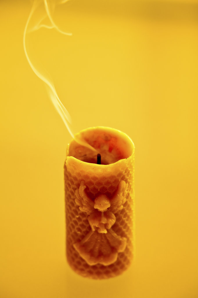 Stock Photo: 1807R-231 Blown out candle on yellow background