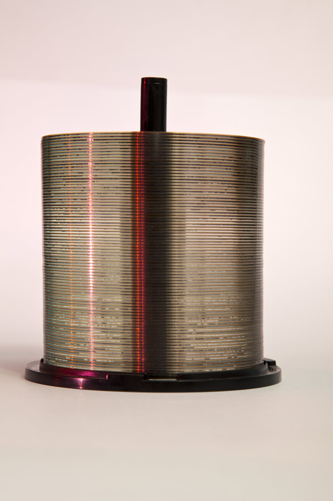 Stock Photo: 1807R-285 Stack of CD's on a spool