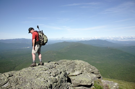 Hiker on Caps Ridge Trail during the summer months. Located in the White Mountains, New Hampshire USA : Stock Photo