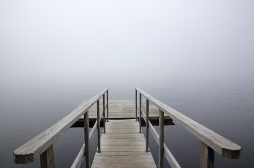 A dock on the Connecticut River in foggy conditions...Located in Waterford, Vermont  USA which is part of New England : Stock Photo