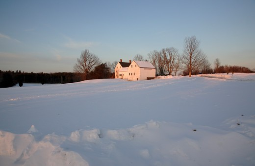 Wagon Hill Farm at sunset during the winter months. Located in Durham, New Hampshire USA which is part of scenic New England : Stock Photo