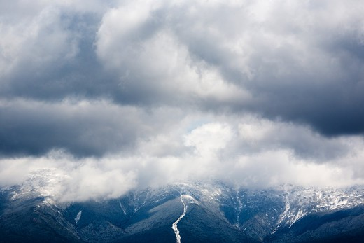 Mount Washington engulfed in storm clouds from the summit of Middle Sugarloaf Mountain during the spring months. Located in Bethlehem, New Hampshire USA : Stock Photo