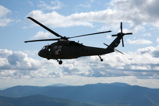 Mount Washington, NH - Search and Rescue Helicopter searching for a missing hiker near Mount Clay. Located in the White Mountains, New Hampshire USA : Stock Photo