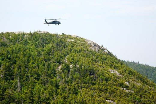 Search and Rescue Helicopter practicing landing on rocky terrain near Mount Chocorua in the White Mountains, New Hampshire USA : Stock Photo