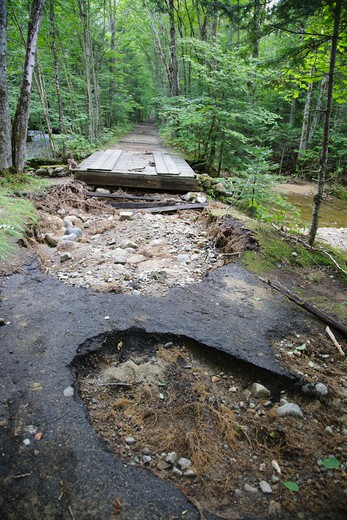 Trail washout along the Lincoln Woods Trail in Lincoln, New Hampshire USA from Tropical Storm Irene in 2011. This tropical storm / hurricane caused destruction along the East coast of the United States and the White Mountain National Forest of New Hampshire was officially closed during the storm. : Stock Photo