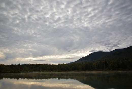 Cloud cover over Durand Lake in Randolph, New Hampshire USA during the summer months : Stock Photo