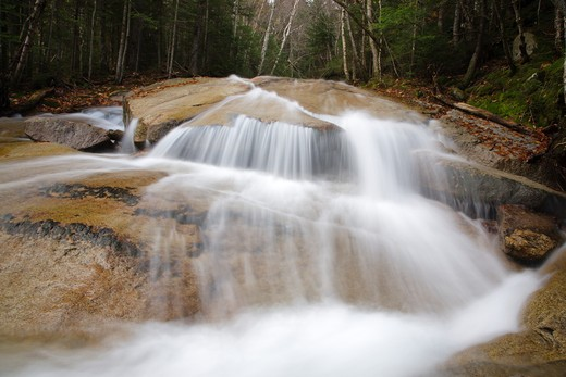 Franconia Notch State Park - Walker Cascades during the autumn months. Located along Walker Brook in the White Mountain National Forest of New Hampshire : Stock Photo
