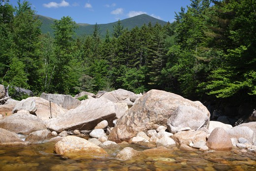 Stock Photo: 1809-16358 Pemigewasset Wilderness - Location of where a timber trestle once spanned the East Branch of the Pemigewasset River in the area of Camp 18 along the East Branch & Lincoln Railroad in the in Lincoln, New Hampshire USA. This was a logging railroad, which operated from 1893 - 1948. Mount Bond is off in the distance