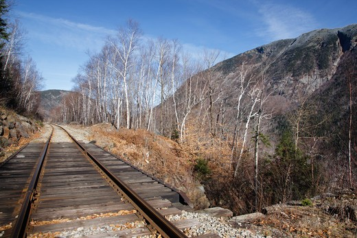 Scenic view from railroad in Crawford Notch State Park of the White Mountains, New Hampshire USA. First known as the Portland & Ogdensburg Railroad chartered in 1867 then sold to the Maine Central Railroad. Since 1995 the Conway Scenic Railroad, which provides passenger excursion trains through the notch has been using the tracks. : Stock Photo