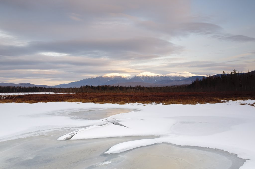 Stock Photo: 1809-17296 Pondicherry Wildlife Refuge - Scenic view of Presidential Range at sunset from Cherry Pond in Jefferson, New Hampshire USA during the winter months