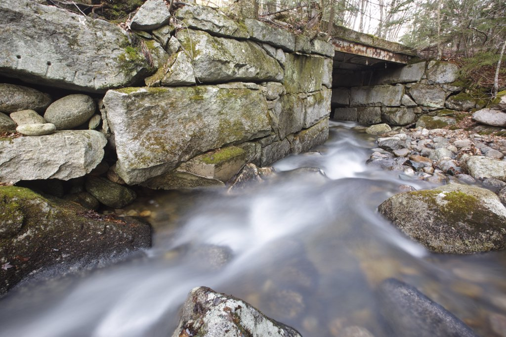Stock Photo: 1809-17380 Old bridge, which crosses Skookumchuck Brook along the Notchway Trail. The Notchway Trail is the main trail of the Lafayette Ski Trails and follows the old Route 3 between Route 141 and Route 18 in the town of Franconia, New Hampshire