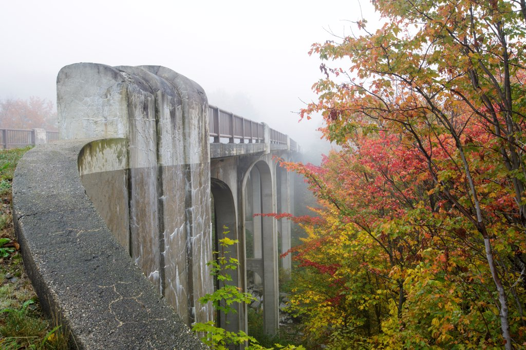 Franconia Notch State Park - The old U.S. Route 3 bridge over Lafayette Brook is closed to traffic and is part of the multi-use trail Franconia Notch Bike Path in the White Mountains, New Hampshire USA : Stock Photo