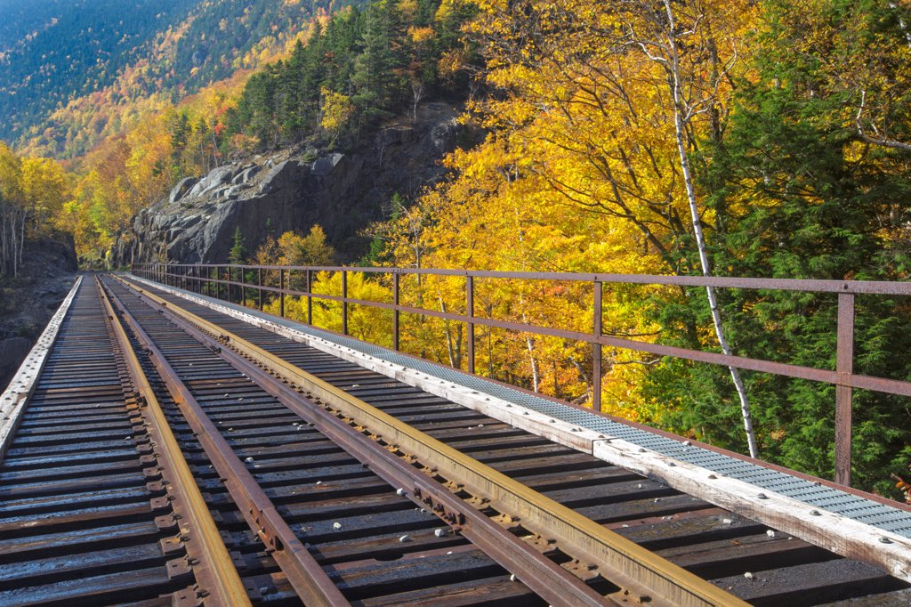 Crawford Notch State Park - Willey Brook Trestle along the old Maine Central Railroad in the White Mountains, New Hampshire USA during the autumn months. This railroad is now used by the Conway Scenic Railroad : Stock Photo