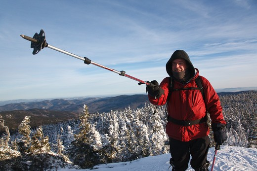 Appalachian Trail - A winter hiker stands on the summit of Mount Moriah during the winter months in the White Mountains, New Hampshire USA : Stock Photo
