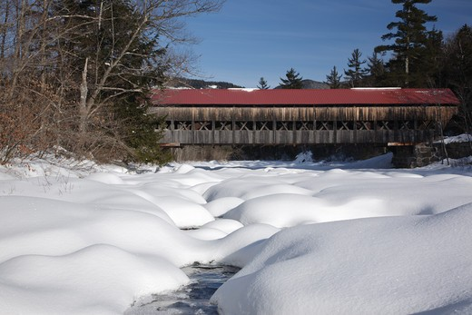 Stock Photo: 1809-6951 Albany Covered Bridge which crosses the Swift River in Albany, New Hampshire, USA just off the Kancamagus Highway. This is the area of 'Blueberry Crossing' along the old Swift River Logging Railroad, which was a logging railroad that operated from 1906 - 1916
