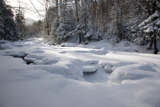 Little River along the North Twin Trail during the winter months in the White Mountains, New Hampshire USA : Stock Photo