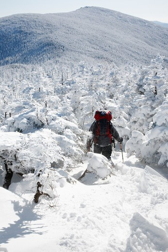 Winter hiker descends from the summit of South Twin Mountain during the winter months in the White Mountains, New Hampshire USA : Stock Photo