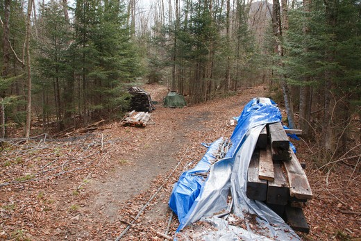 Stock Photo: 1809-8570 Pemigewasset Wilderness - Remains of suspension bridge on side of Trail. This footbridge was along the Wilderness Trail and crossed the Pemigewasset River in Lincoln, New Hampshire USA. These remains will be removed from the wilderness at a later time