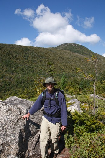Zealand Notch  - A hiker on the Zeacliff Trail during the summer months in the White Mountains, New Hampshire USA. Zeacliff Mountain is in the background : Stock Photo