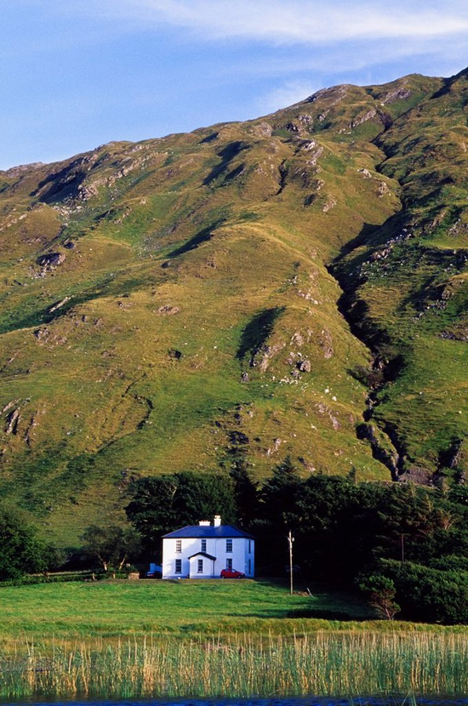 Stock Photo: 1812-10029 Benbaun Mountain, Connemara National Park, County Galway, Ireland, House at base of tall mountain