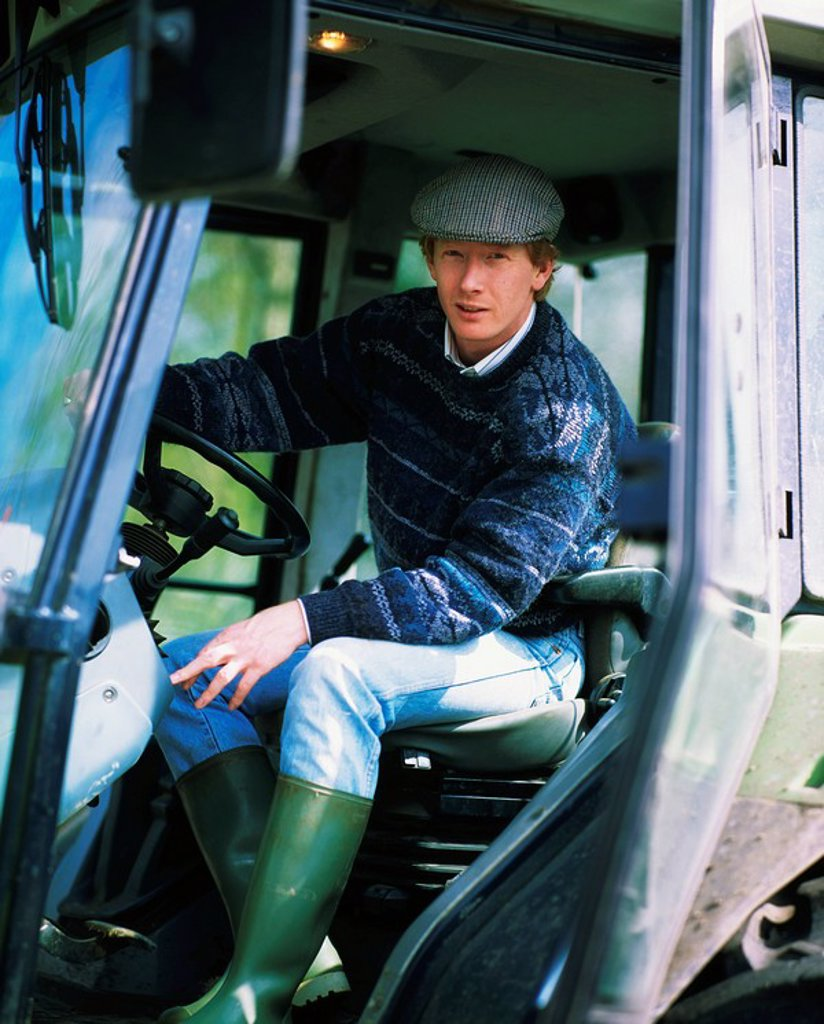 Stock Photo: 1812-10180 Ireland, Farmer driving his tractor
