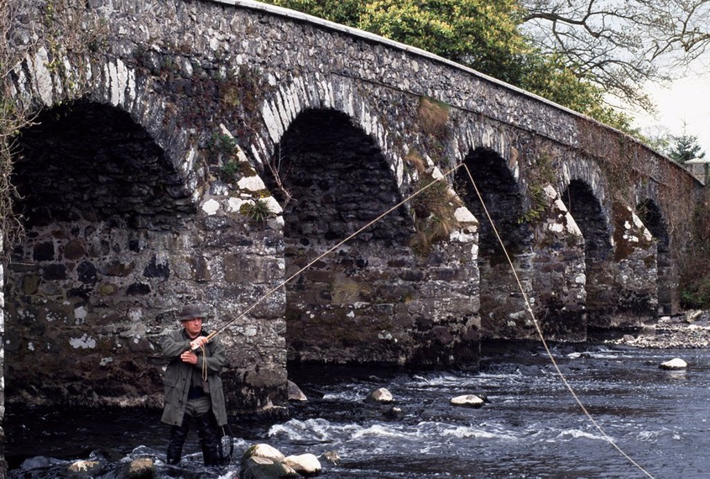 Stock Photo: 1812-10200 Maine River, Co Antrim, Northern Ireland, Man fly fishing under bridge