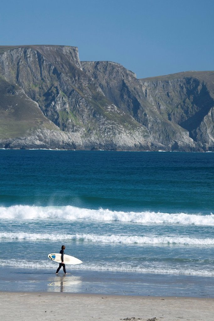 Stock Photo: 1812-10656 Achill Island, Co Mayo, Ireland, Surfer walking along Trawmore beach