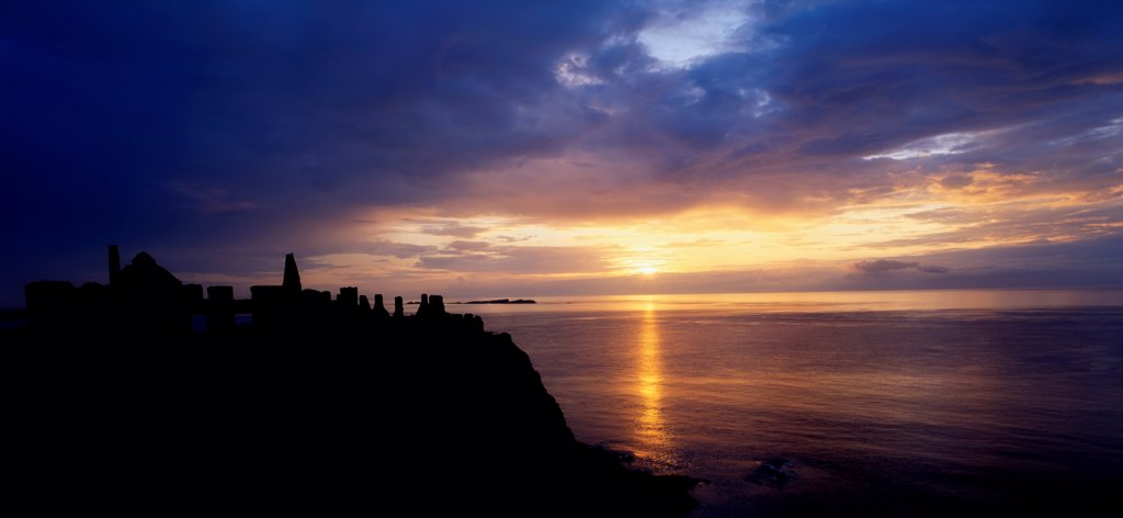 Stock Photo: 1812-16070 Dunluce Castle At Sunset, Co Antrim, Ireland