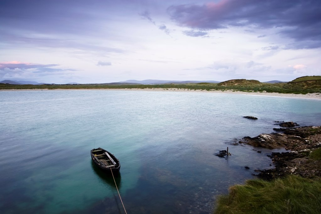 Stock Photo: 1812-17896 Dogs Bay, Roundstone, County Galway, Ireland; Fishing Boat In Water At Sunset