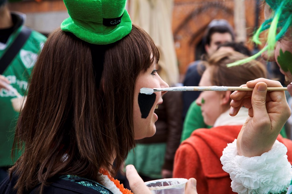 Dublin, Ireland; A Woman Gets Her Face Painted For Saint Patrick's Day : Stock Photo