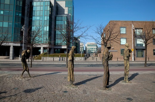 Contemporary Sculptures Of Famine Victims With The International Financial Services Centre In Background; Dublin City Ireland : Stock Photo