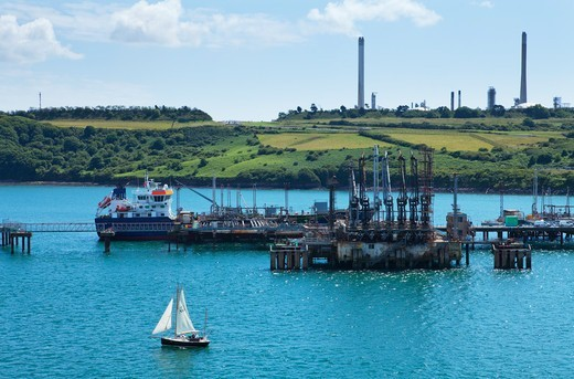 Boat At Refinery; Milford Haven Pembrokeshire South Wales : Stock Photo