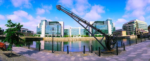Crane on a riverbank, International Financial Services Centre, Dublin, Republic Of Ireland : Stock Photo