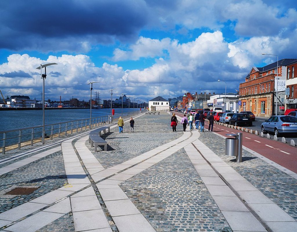 North Quays and River Liffey, Dublin, Co Dublin, Ireland, Cobblestone walkway along the river : Stock Photo