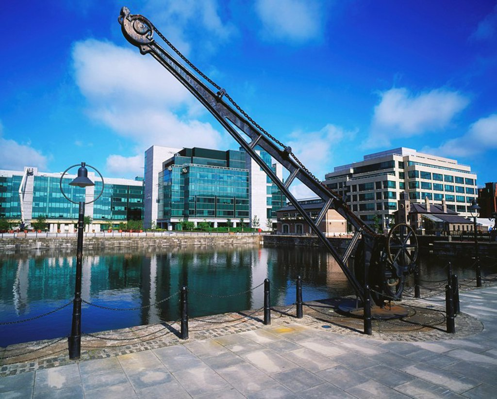 Stock Photo: 1812-7707 IFSC, Dublin City, Ireland, Riverside sculpture against cityscape