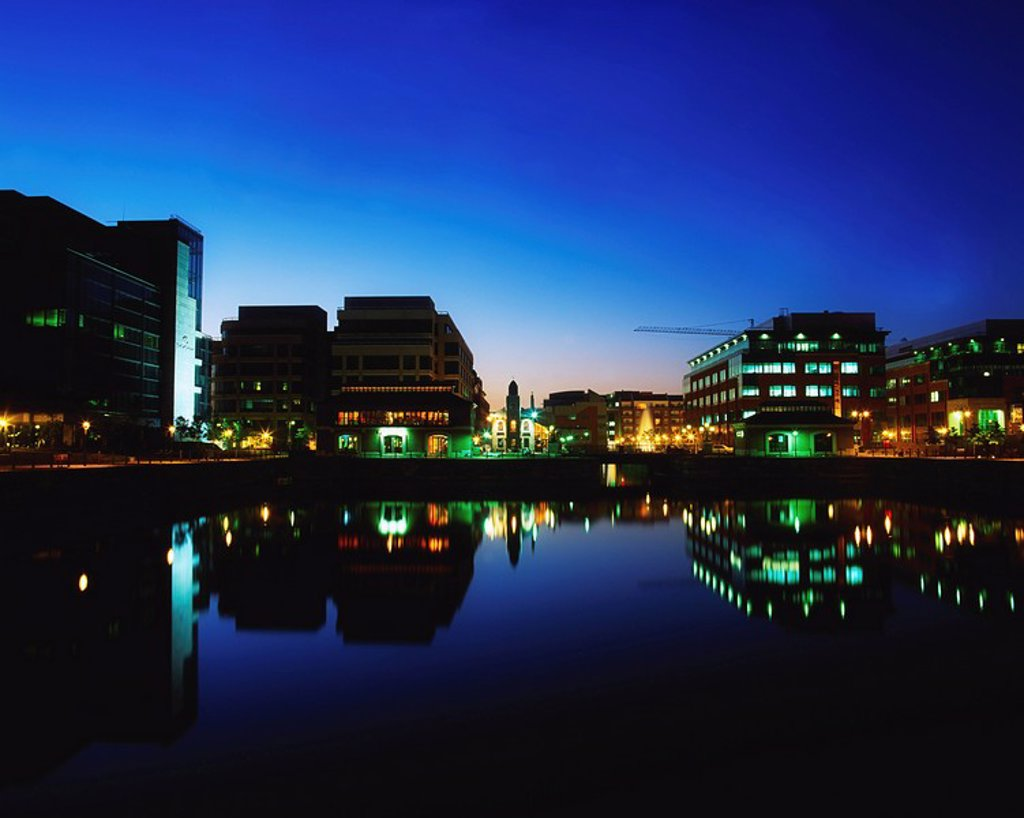 IFSC, Dublin, Ireland, Building lights reflected in river at night : Stock Photo