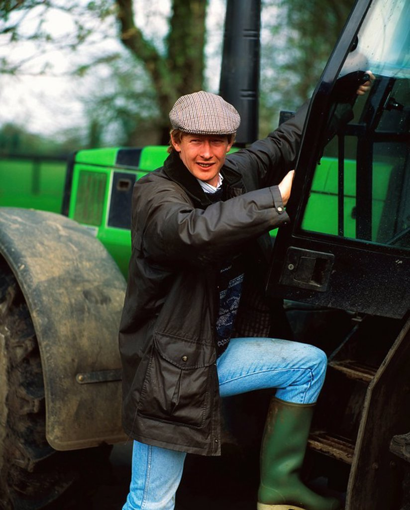 Farmer and tractor, Ireland : Stock Photo