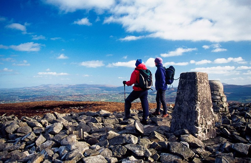 Stock Photo: 1812-9897 Hiking through neolithic burial chamber at the summit of Slieve Gullion, County Armagh, Northern Ireland