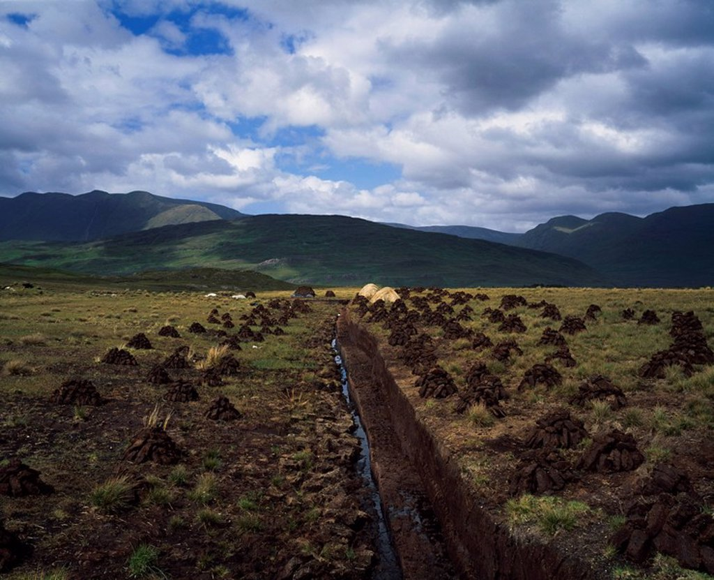 Stock Photo: 1812R-14548 Turf being cut and dried, near Leenane, Co Galway, Ireland