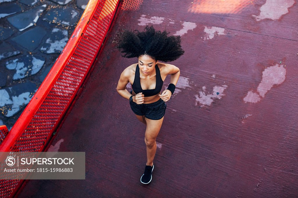 Stock Photo: 1815-15986883 Spain, Barcelona, jogging young woman
